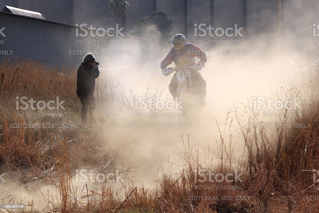 Motorbike airborne over bump at rally stock photo