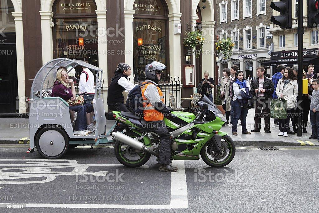 Motorbike and Rickshaw Using a Bike Box in London stock photo
