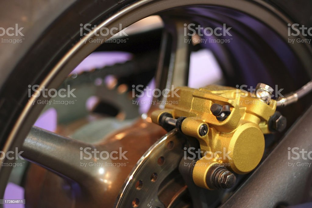 Motorbike brake caliper and disc stock photo