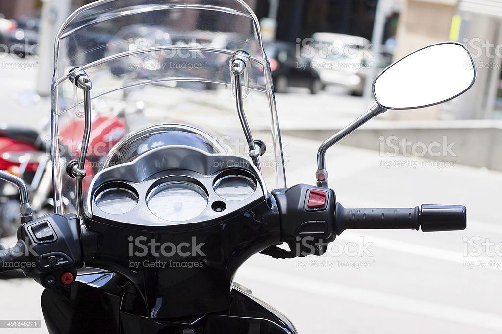 Motorbike handlebars with dashboard and reversing mirror stock photo