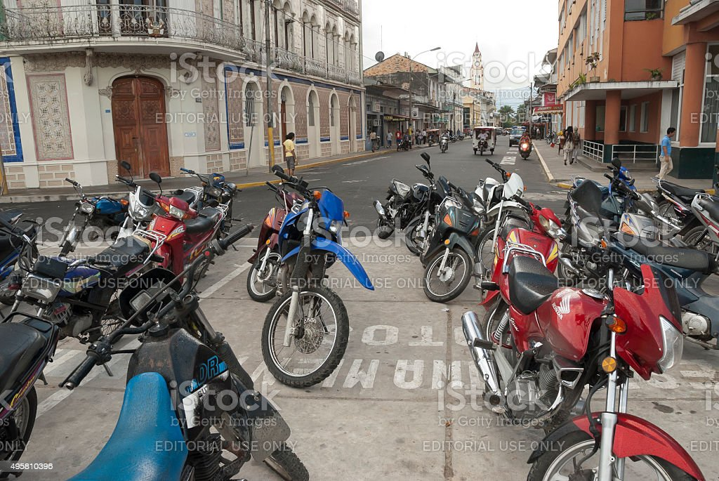 Motorbike parking on a street of Iquitos, Peru. stock photo