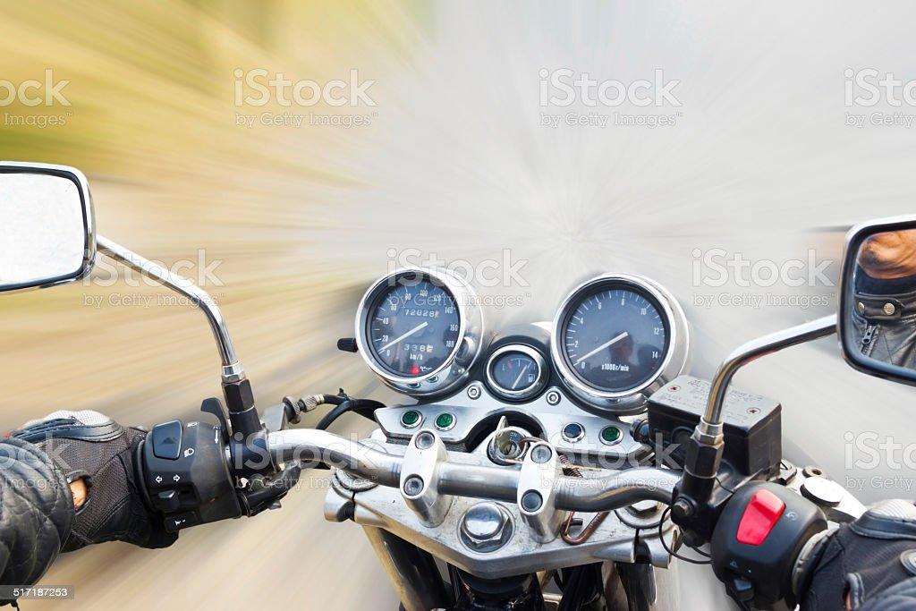 motorbike rides on the street stock photo