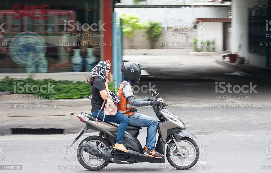 Motorbike taxi carrying a passenger stock photo