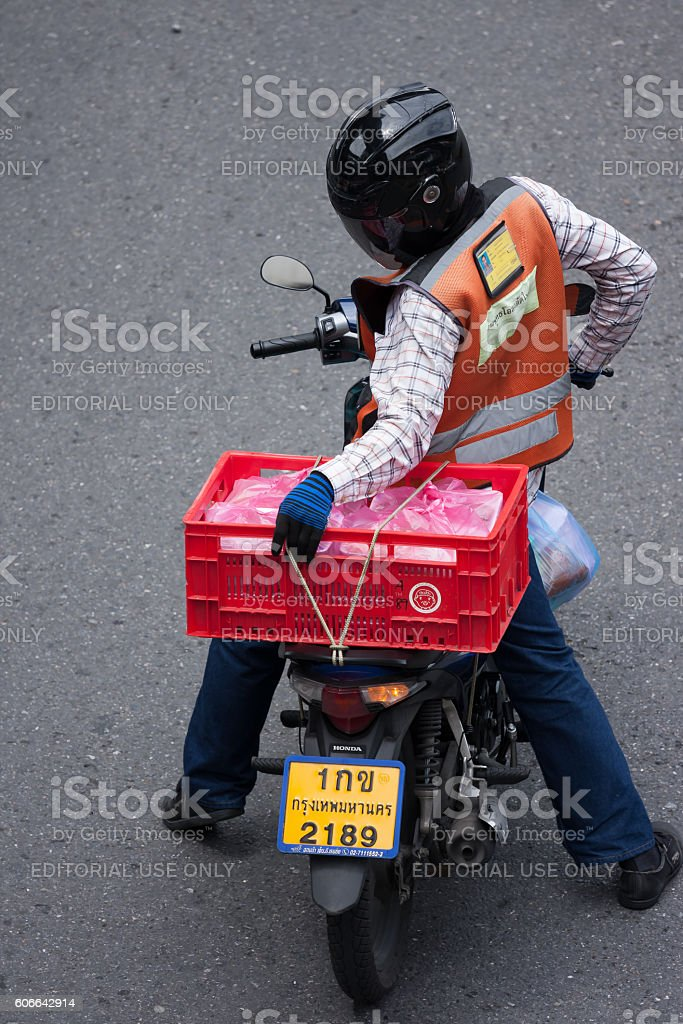 Motorbike taxi delivers goods stock photo