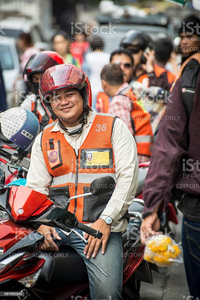 Motorbike taxis wait for passengers in Bangkok street. stock photo
