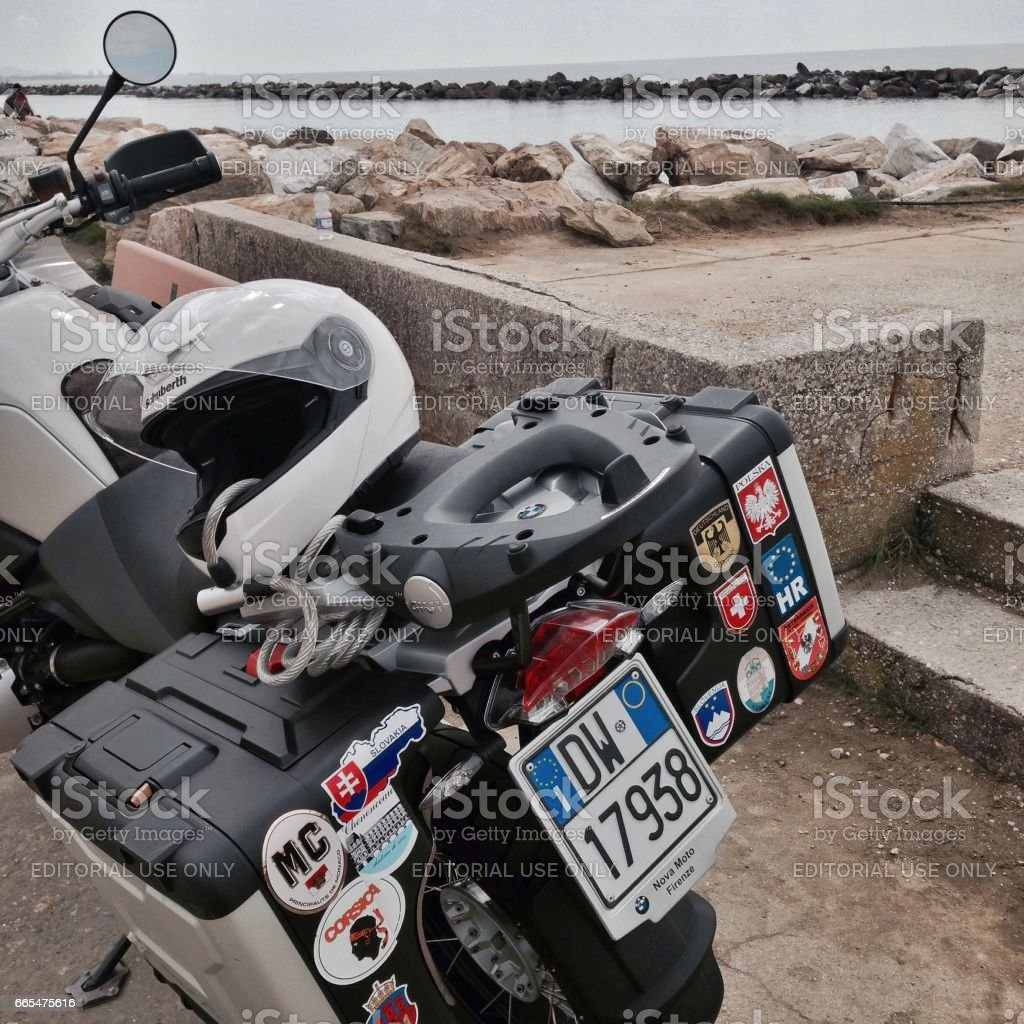Motorbike that has travelled a lot stock photo