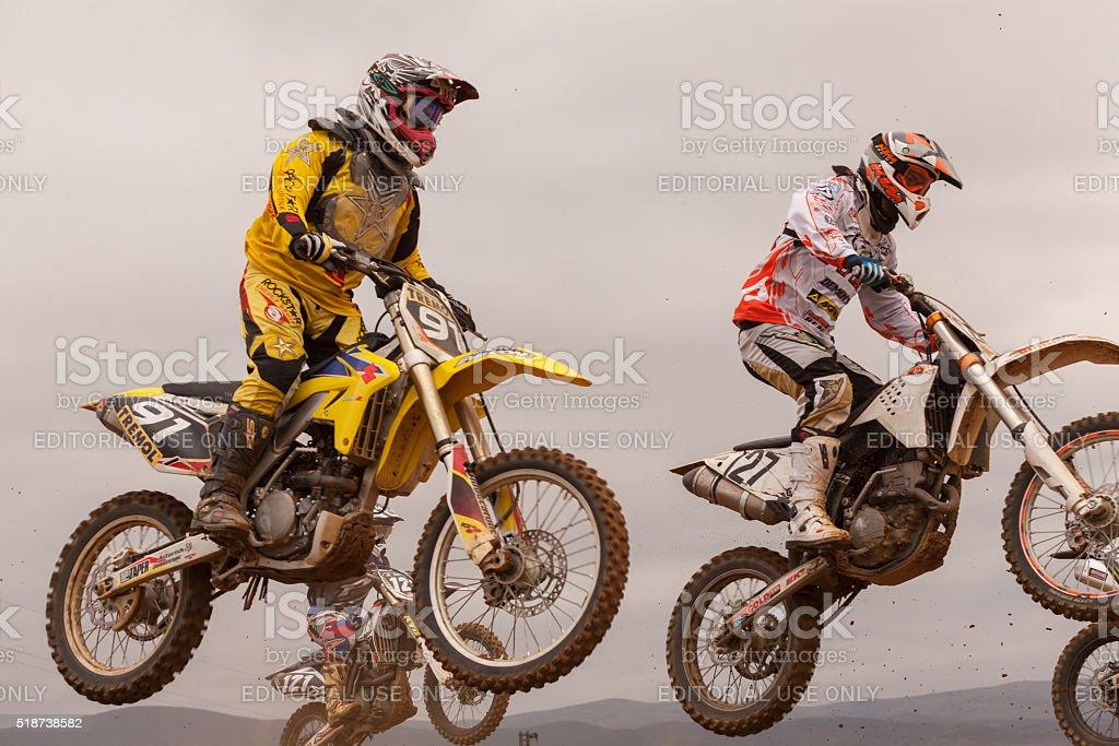 Motorbikes in flight, bike jump at the 'GP POMORIE' 2013. stock photo