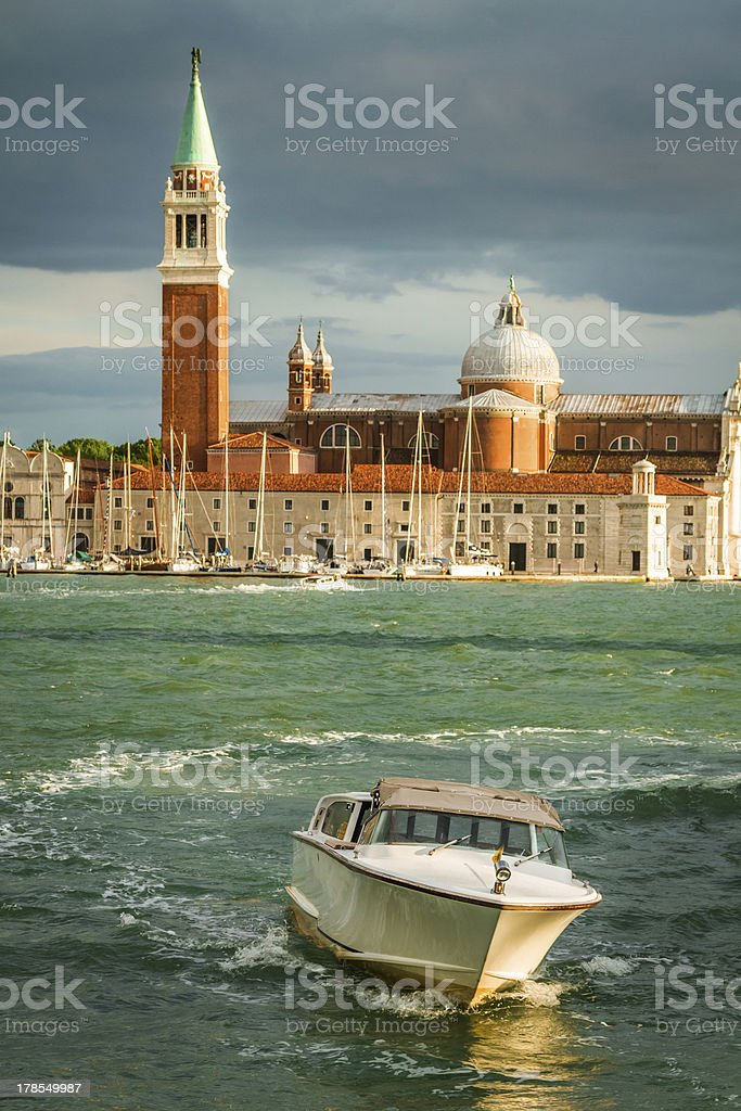 Motorboat and Church of San Giorgio Maggiore in Venice royalty-free stock photo