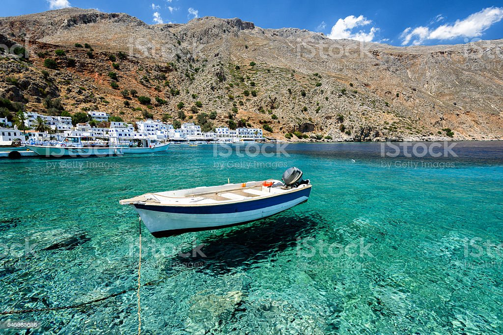 Motorboat at bay of Loutro town on Crete island stock photo