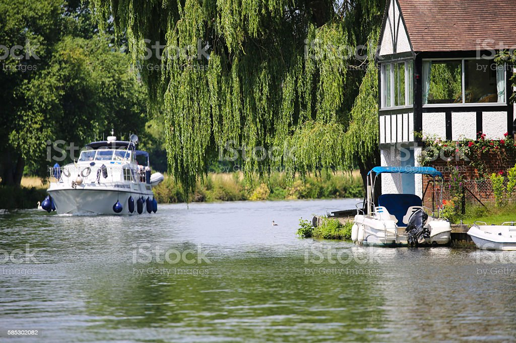 Motorboat cruising down the river Thames stock photo