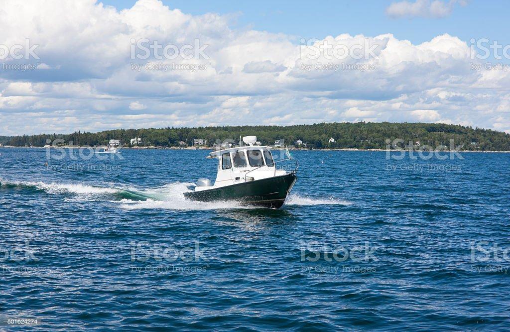 Motorboat sailing along the coast stock photo