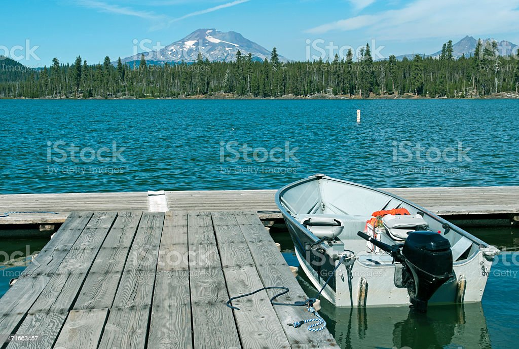 Motorboat tied to dock at Lava Lake in central Oregon royalty-free stock photo