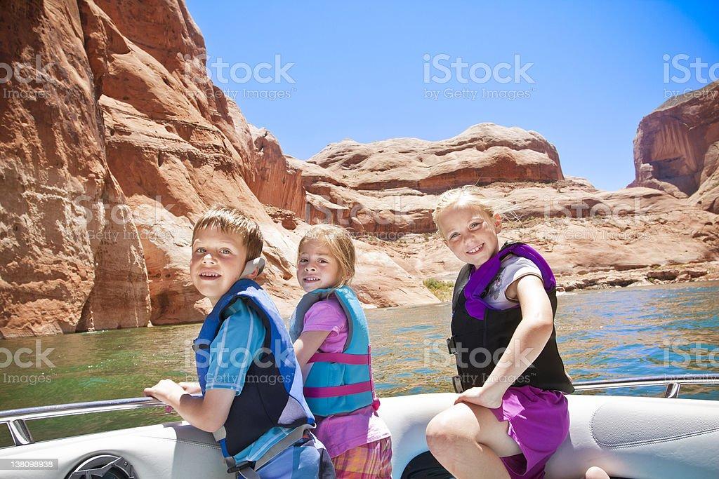 Motorboating fun - Children stock photo