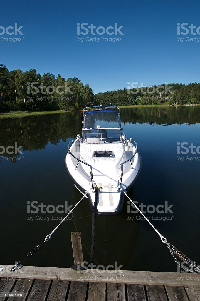 motorboats by a dock royalty-free stock photo