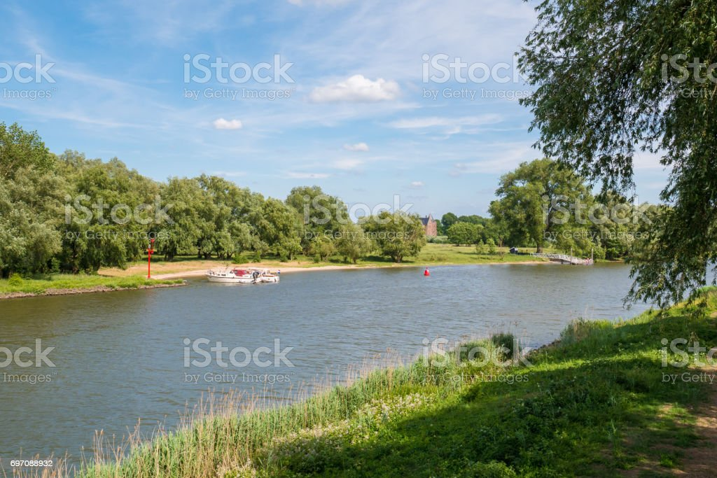 Motorboats on river Afgedamde Maas near Woudrichem, Netherlands stock photo