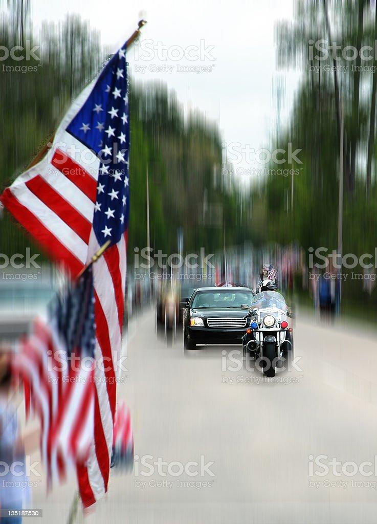 Motorcade, parade. USA flags. Motorcycle, police, limousine. Street. stock photo