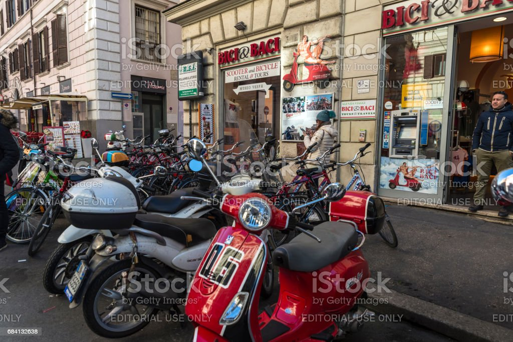 Motorcycle and bicycle rental shop in Rome, Italy stock photo