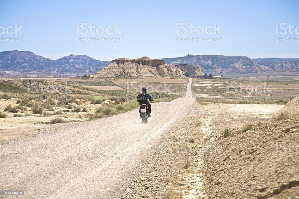 motorcycle at desert road stock photo