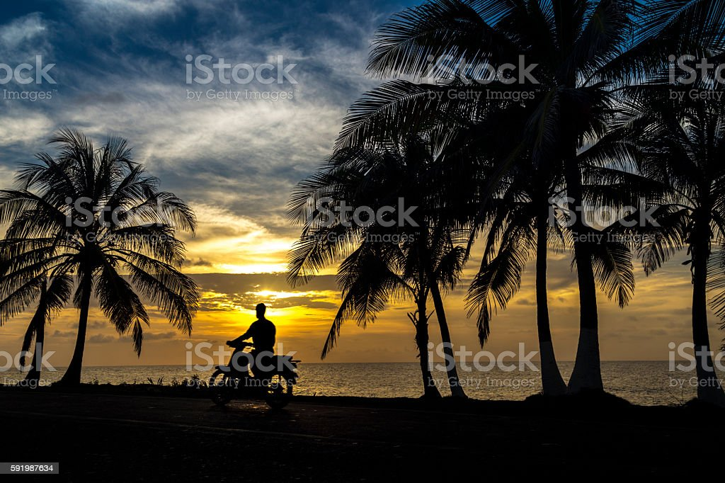Motorcycle at tropical coast stock photo
