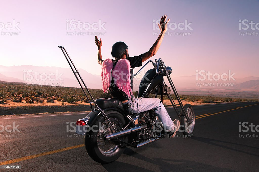Motorcycle Biker on the Open Road with Angel Wings stock photo