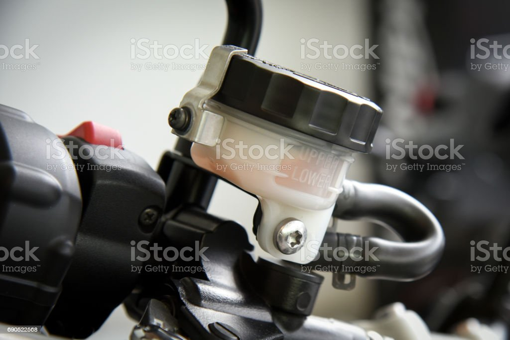 motorcycle brake fluid, brake master cylinder reservoir stock photo