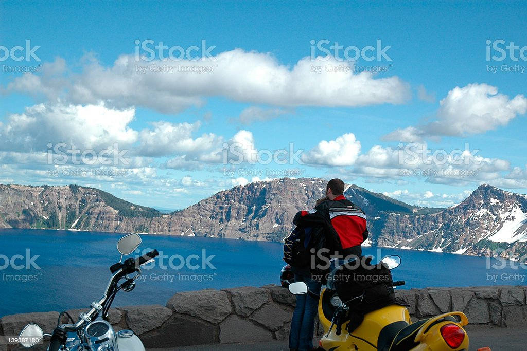 Motorcycle couple at crater lake royalty-free stock photo