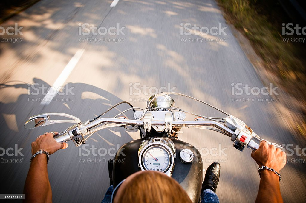 Motorcycle cruising, above rider's view stock photo