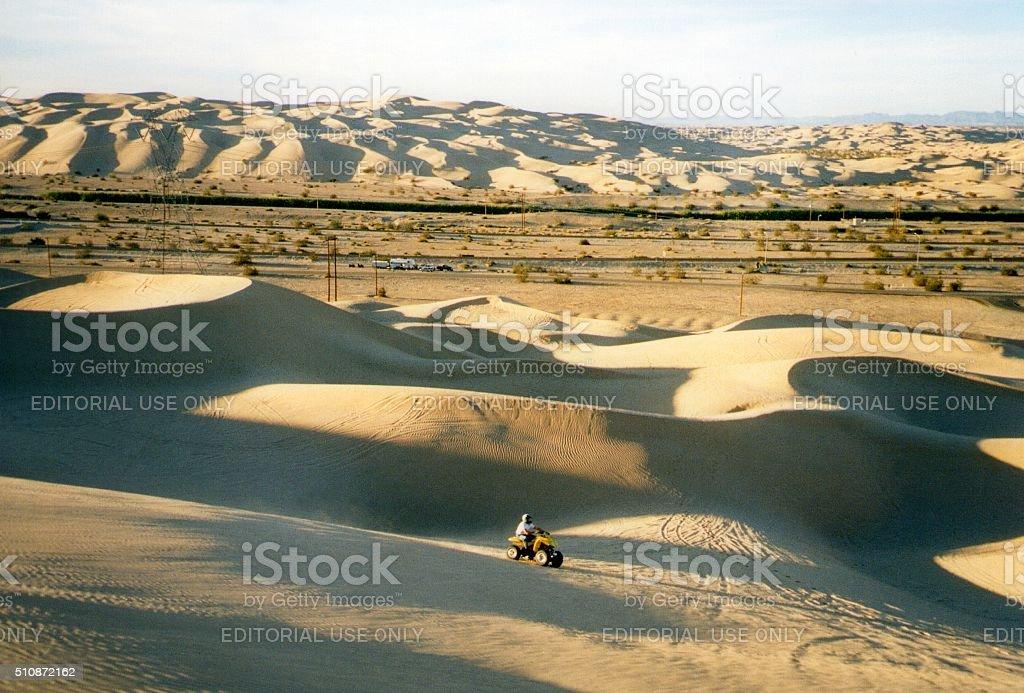ATV motorcycle driver on Algodones dunes, Southern California stock photo