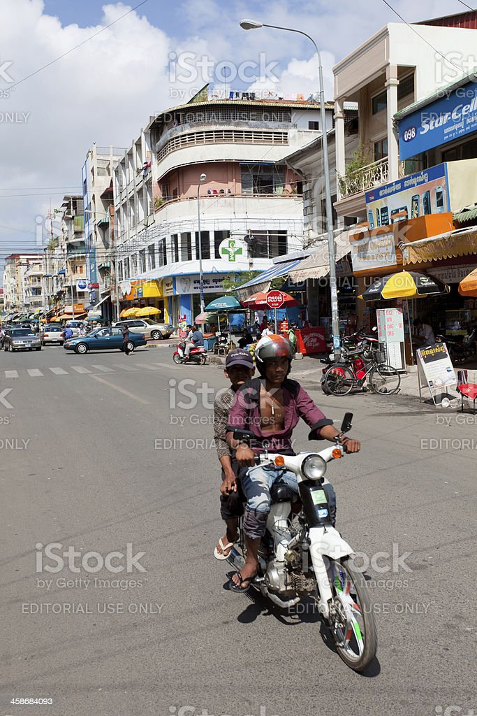 Motorcycle driving carrying Alms, Phnom Penh, Cambodia royalty-free stock photo