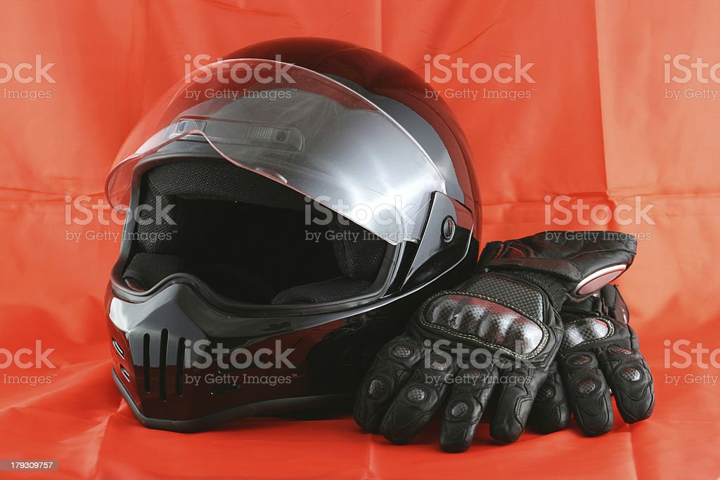 Motorcycle helmet and leather gloves stock photo