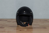 Motorcycle helmet on wooden table