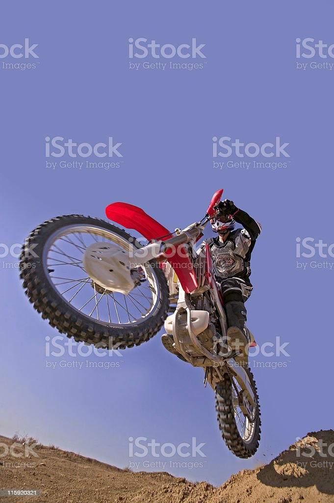 Motorcycle Jumping against Blue Sky stock photo
