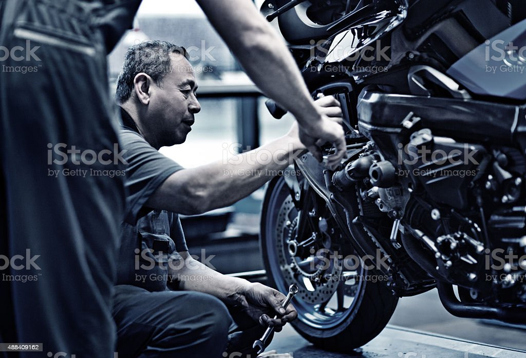 Motorcycle Mechanic at Work stock photo
