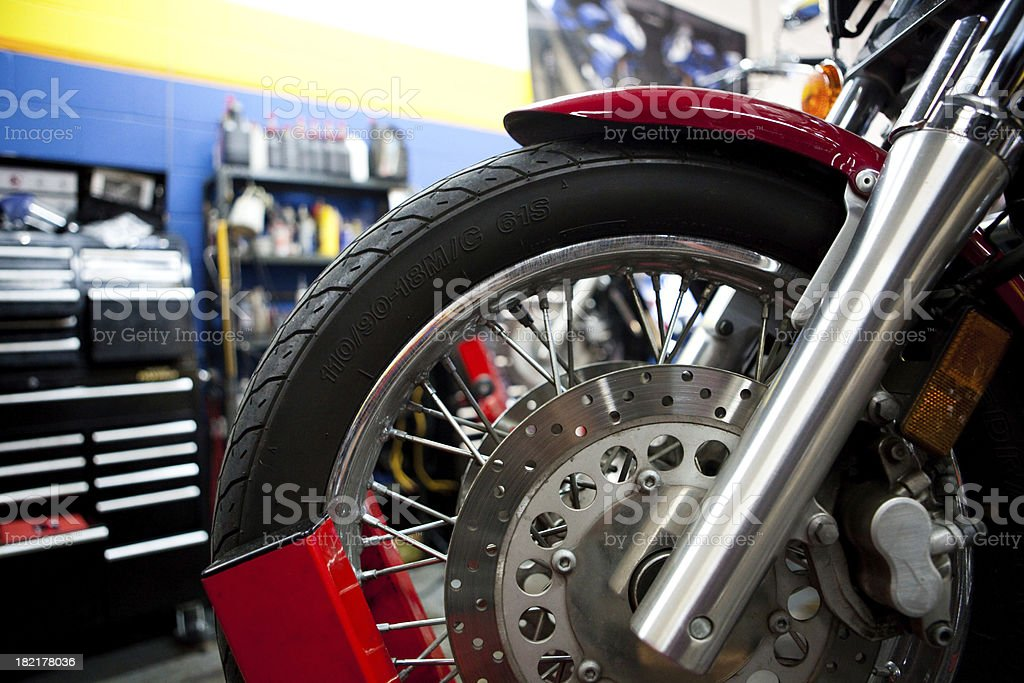motorcycle mechanic shop stock photo