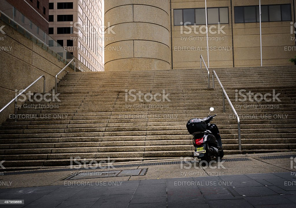 Motorcycle / moped parked down stairs stock photo