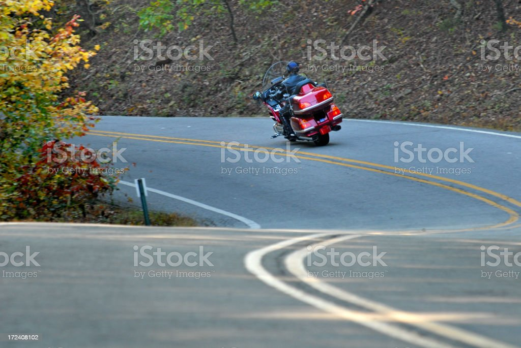 Motorcycle on Curvy Highway royalty-free stock photo