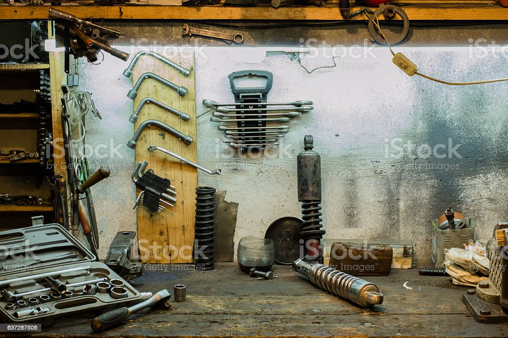 Motorcycle parts on the desktop in the garage stock photo