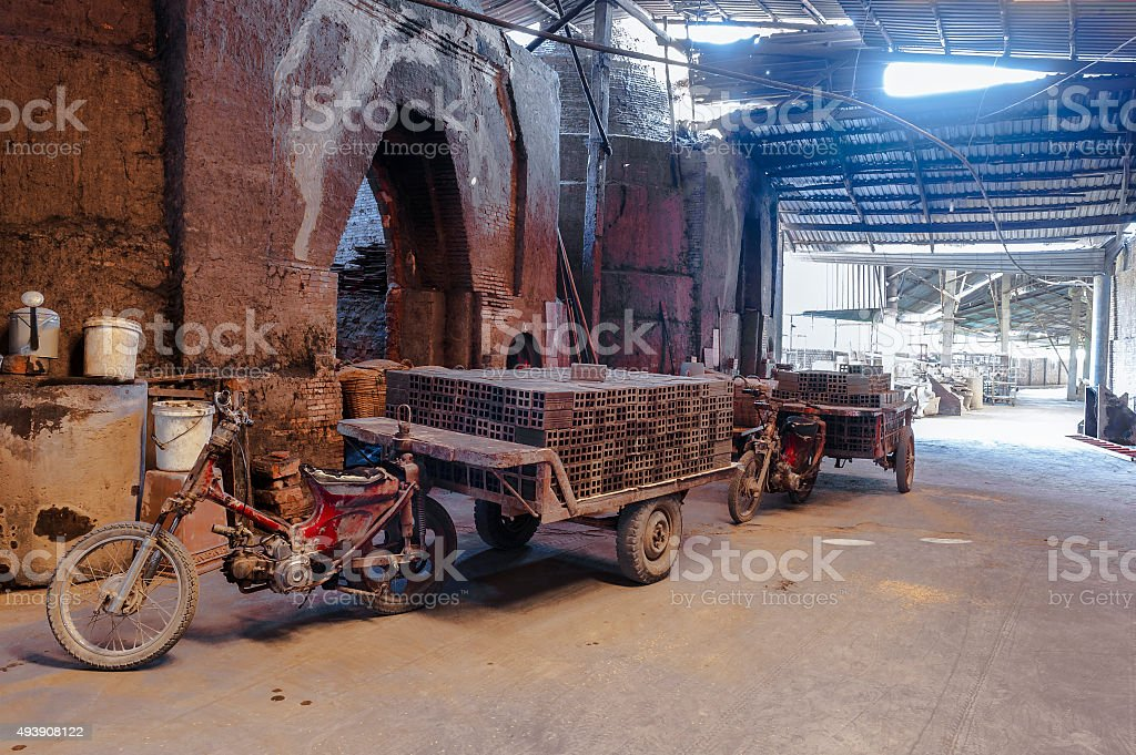 Motorcycle pull a trailer loading full of brick blocks. stock photo