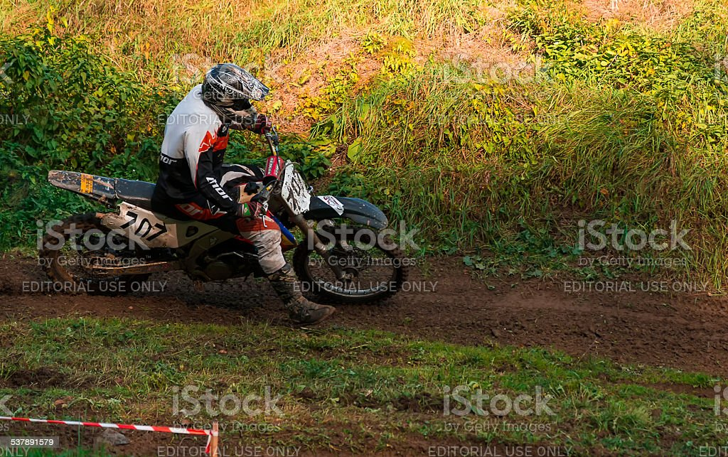 Motorcycle racer overcomes abrupt turn stock photo