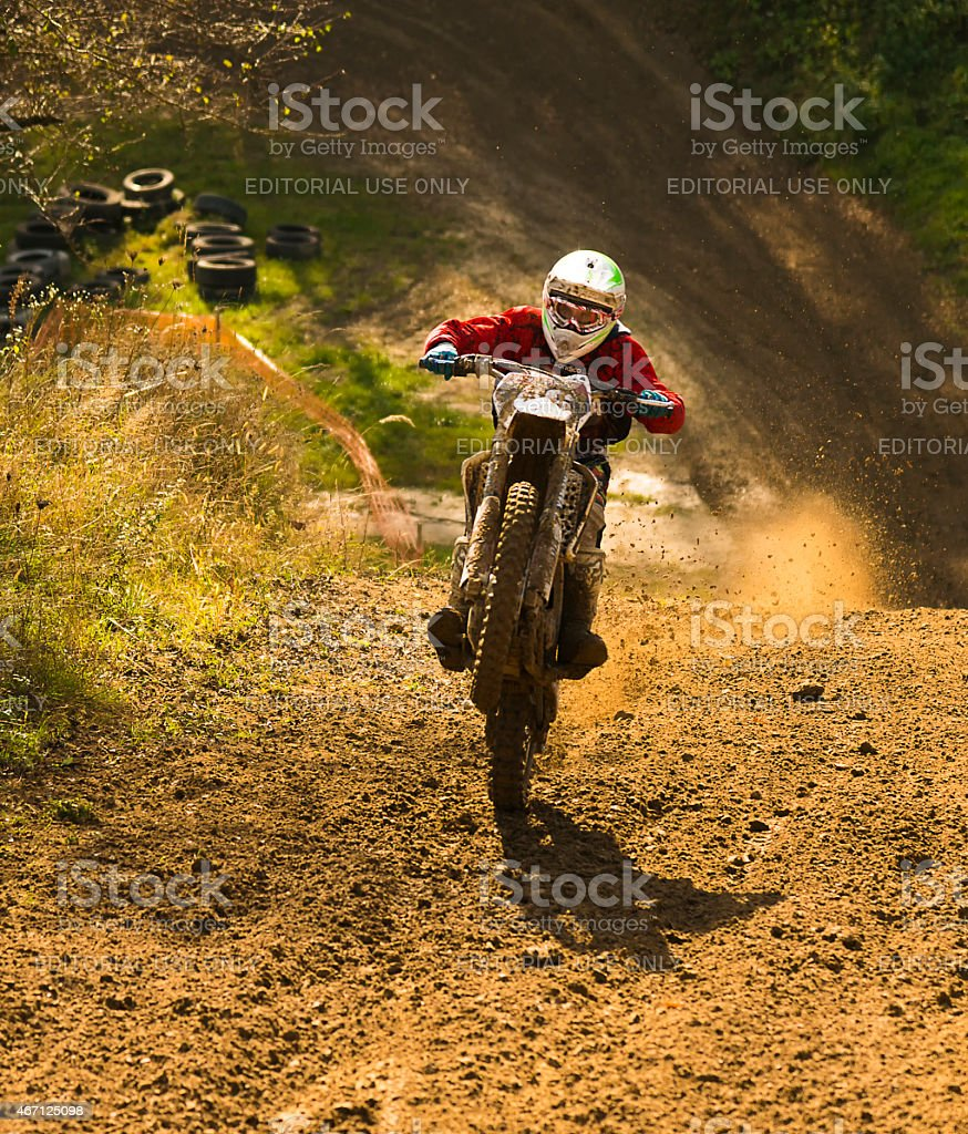 Motorcycle racer overcomes the steep climb stock photo