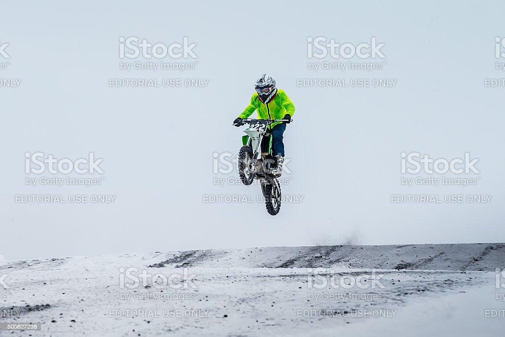 motorcycle racer winter race stock photo