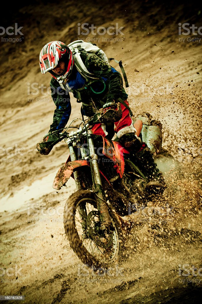 Motorcycle rider in mud riding a motocross race stock photo