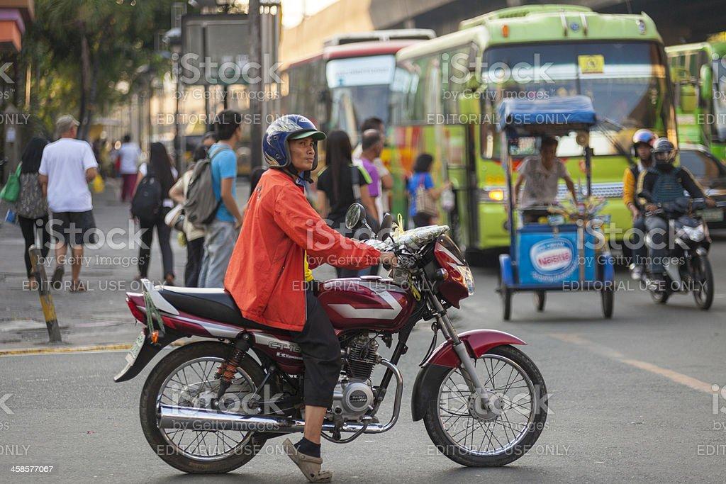 Motorcycle rider Malate, Manila stock photo