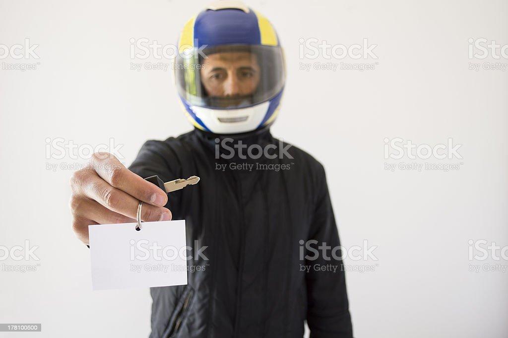 Motorcycle salesman with helmet giving the keys stock photo