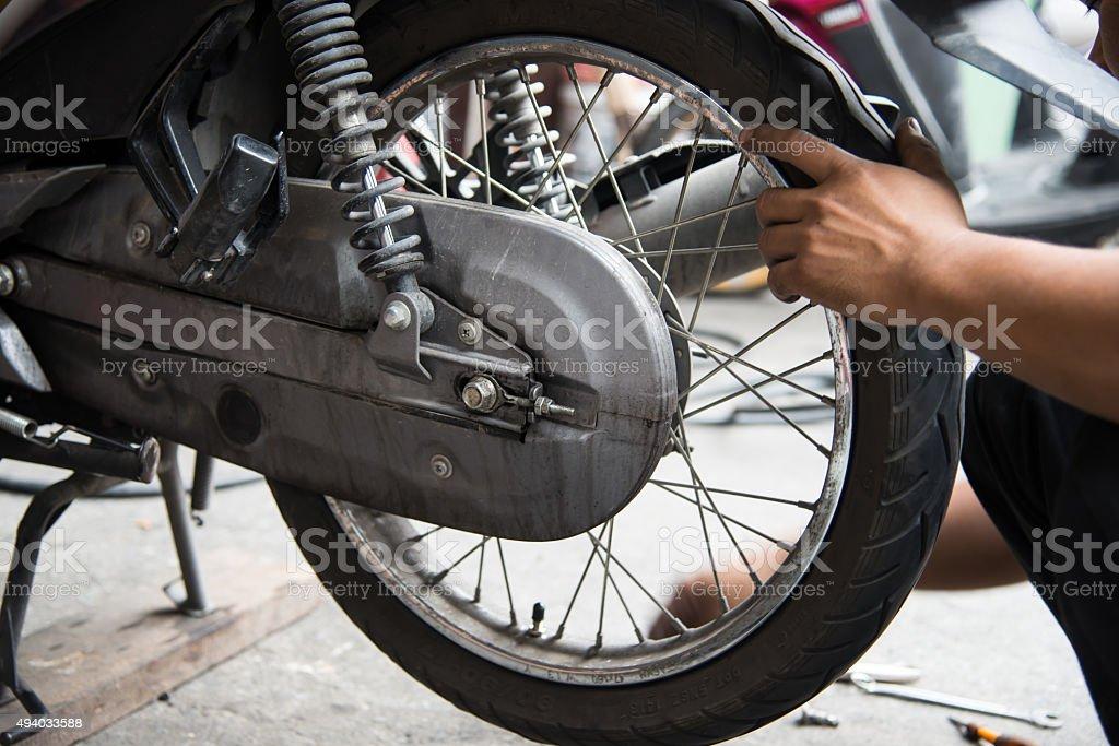 Motorcycle tire repair stock photo