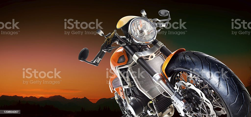 Motorcycle with an orange night background royalty-free stock photo