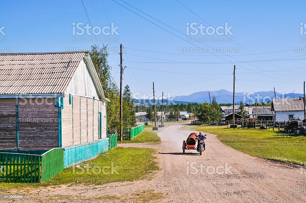 Motorcycle with sidecar on the street in the village Sordonnoh. stock photo