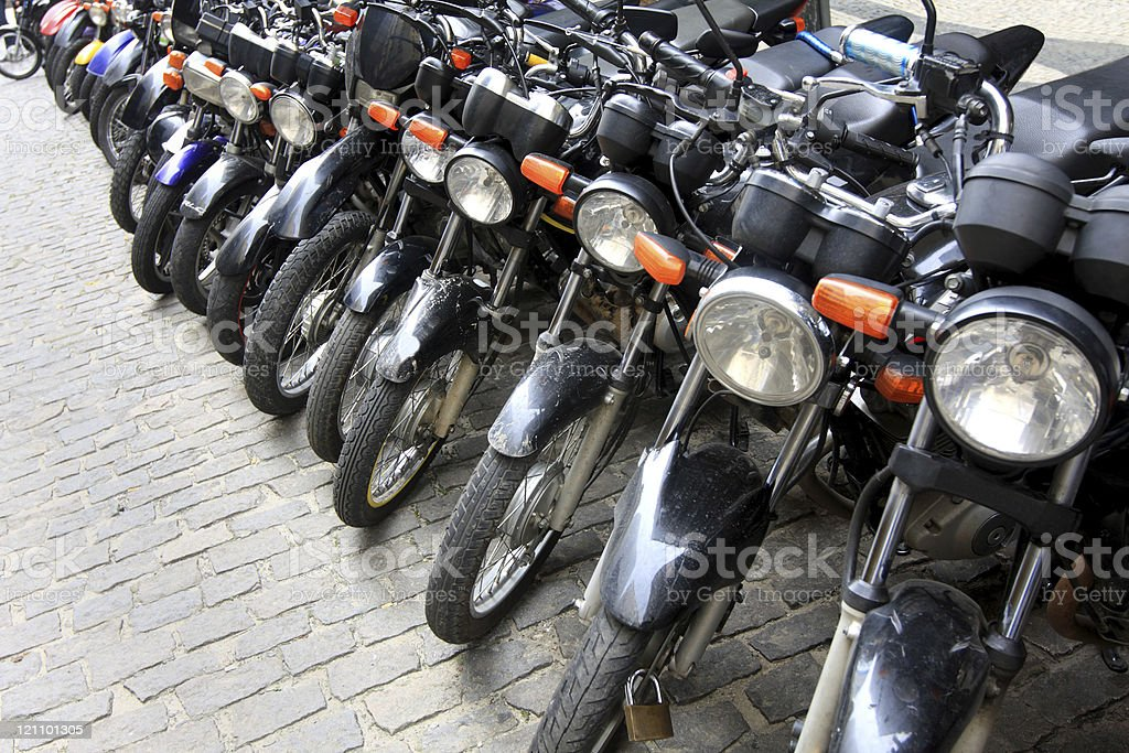 Motorcycles parked on the street royalty-free stock photo