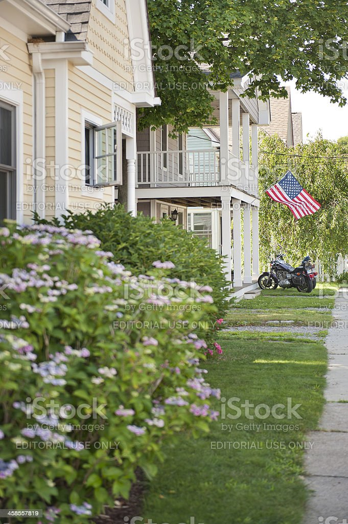 Motorcycles parked under USA flag royalty-free stock photo