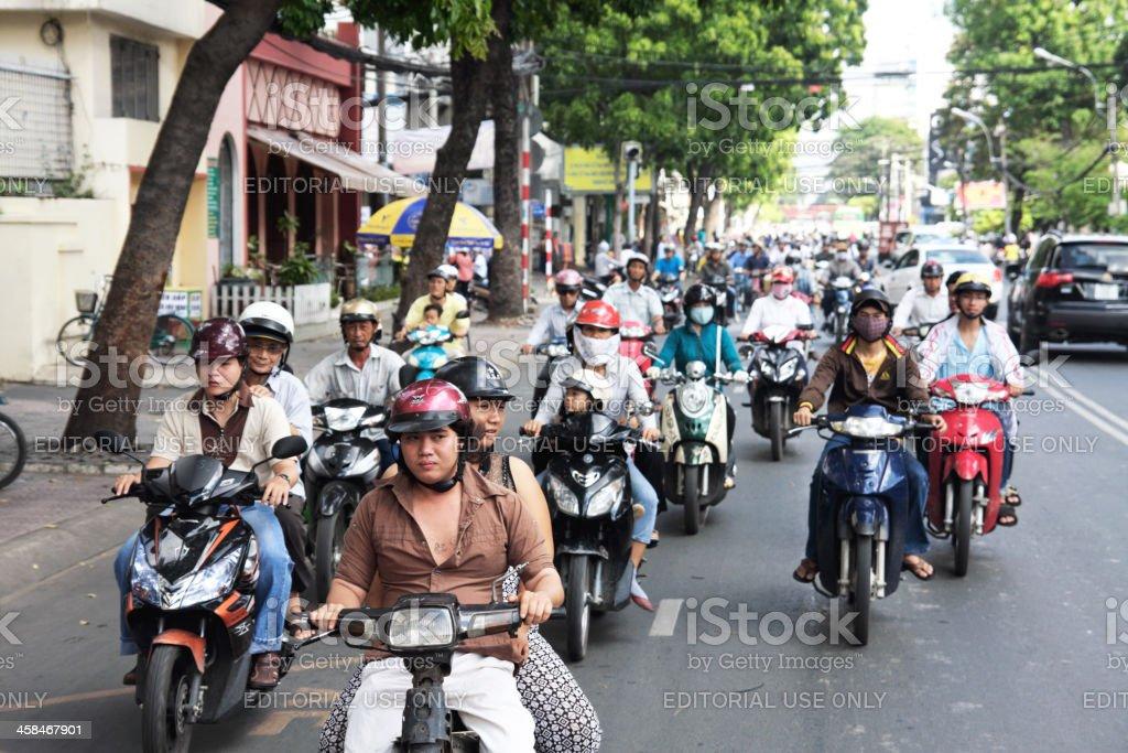 Motorcycles riders in Ho Chi Minh city (Saigon) royalty-free stock photo